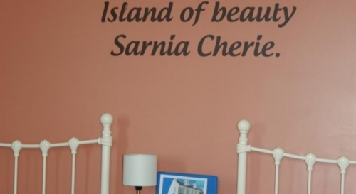 Sea view twin decor, Displaying the Guernseys Anthem name 'Sarnia Cherie'