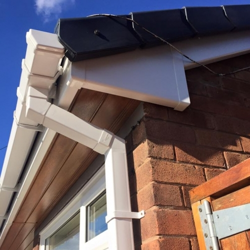 White Fascia with Brown soffit