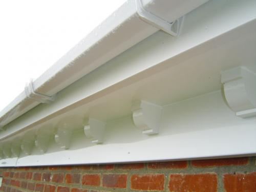 Double Ogee Fascia Boards with Square line gutters and Dentil Moulds