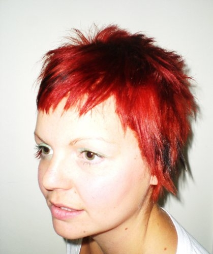 funky choppy pixie cut bright red with black chunky low lights