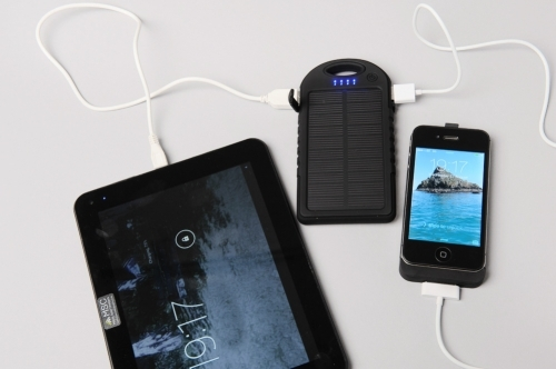 MSC Sport waterproof 5000mah solar charger with iPhone 4 and Tablet