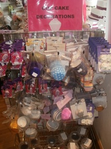 A large selection of cupcake decorations non and edible sprinkles and topping. We sell the boxes and ribbons too. SEE all our cake decorations on our website www.enticingcakedecorations.co.uk