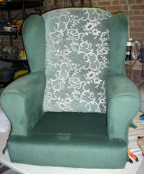 Wing arm chair with legs off before reupholstery