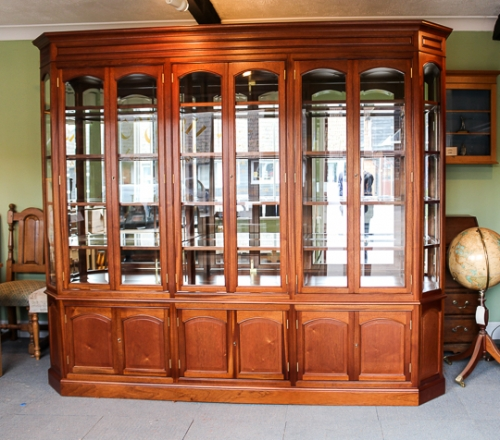 Mahogany display cabinet with bevelled glass