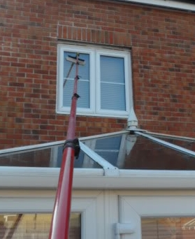Window cleaning above a conservatory