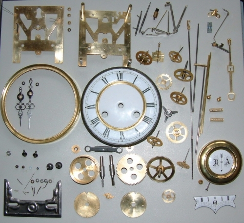 A German wall clock after stripping and cleaning, ready for reassembly