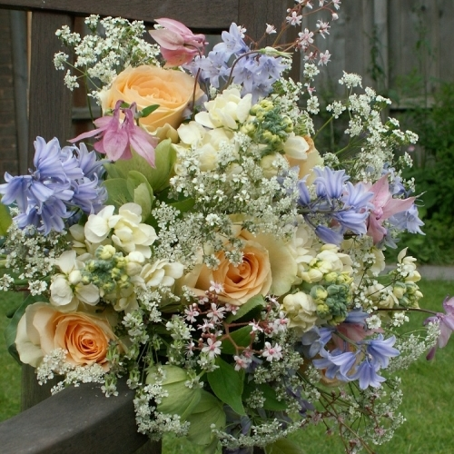 Gorgeous mix of late spring flowers, bluebells, aquilegia, london pride, hellebores and roses.