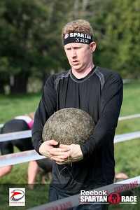 Moving heavy single items. Carrying an Atlas Stone at a Spartan Race