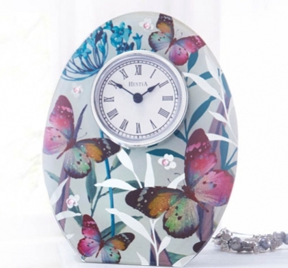Butterfly Clock Sku: 787981  £13.00 Stunning free-standing 3D-effect glass mantle clock with glittered butterfly design. Requires 1x AAA battery (not supplied).