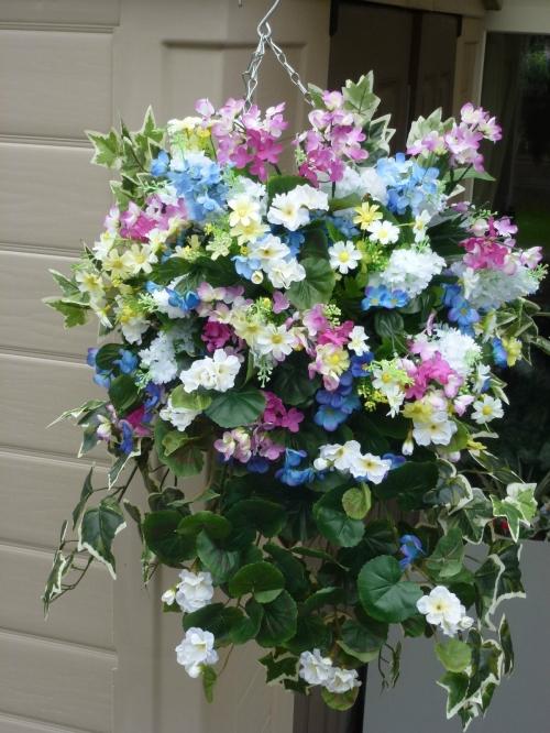 Hanging basket with artificial white geranium