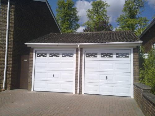 Carteck Georgian Sectional Garage Doors with rhombus mullion windows